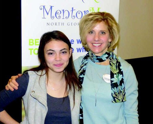 Mentor Sara Harrison right and Aura